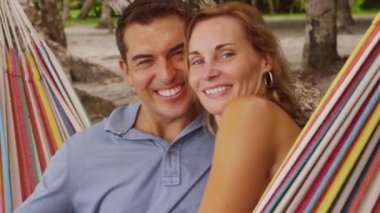 Couple sitting in hammock — Stock Video