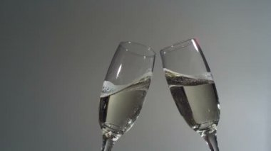 Champagne glasses toast in super slow motion. Shot with Phantom camera at 6900 frames per second. — Stock Video