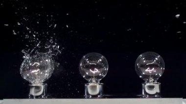 Lightbulbs hit by slingshot — Stock Video