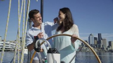 Couple on sailboat — Stock Video