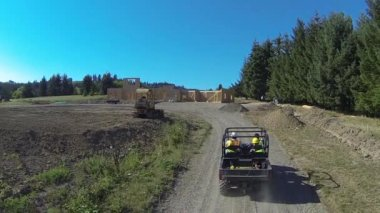 Workers driving utility vehicle — Stock Video
