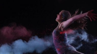 Colored powder hitting girl — Stock Video