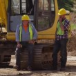 Two workers by excavator — Stock Video #65821513