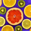 Background of different kinds citrus fruits and kiwis — Stock Photo #66427345