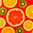 Background of different kinds citrus fruits and kiwis — Stock Photo #66427357