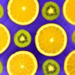Background of different kinds citrus fruits and kiwis — Stock Photo #66427401