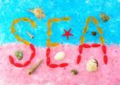 Sea inscription on a pink and blue sea salt — Stock Photo
