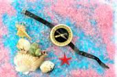 Shells, star and tourist compass on sea salt — Stock Photo