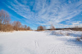 Beautiful clouds on a blue sky in winter — Stockfoto