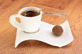 Black tea in a white mug and cake — Stock Photo