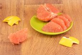 Ripe grapefruit on a wooden background — Stock Photo