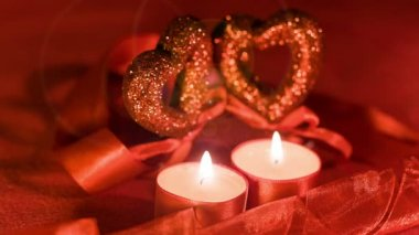 Valentines day, two candles burning in front of hearts — 图库视频影像