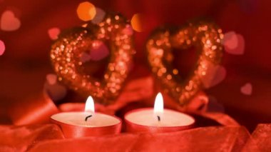 Valentines day, two candles burning near two hearts, closeup — Stok video