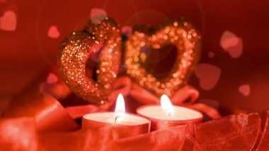 Valentines day, two candles burning in front of falling hearts — 图库视频影像