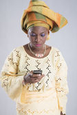 Woman looking attentively at phone isolated — Stock Photo