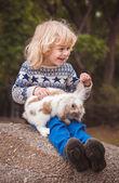 Boy and rabbit — Stock Photo