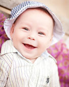 Baby grins — Stock Photo
