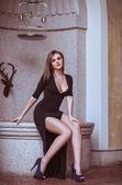Beautiful girl in a black dress — Stock Photo