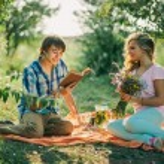 Teenage couple dating on picnic — Stock Photo #64581477