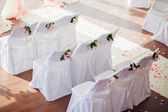 Wedding chair covers with flowers — Stock Photo