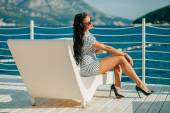 Fashion luxury lady model on beach chill out — Stock Photo