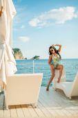 Luxury fashion sexy bikini model on sunbed chill out — Stock Photo