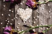 Heart shape of white lilac flowers on wood table — Stock Photo