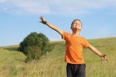 Young happy child playing in  meadow.Freedom concept. — Stock Photo