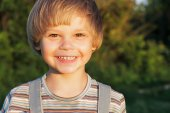 Portrait of  adorable young boy at sunset in nature. — Stock Photo