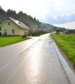 Image of cozy houses along the road — Stock Photo