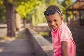 Boy sitting on border — Stock Photo
