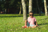 Afro American boy sitting on grass — Stock Photo