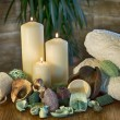 An arrangement of scented candles,  at a spa, aromatic dried plant parts and towels Body — Stock Photo #64431911