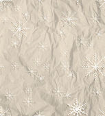 Paper wrinkled texture with snowflakes — Stock Vector