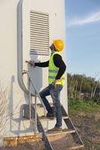 Engineer working in a wind turbine area — Stock Photo