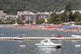 People sunbathing and swimming at Budva Beach — Stock Photo
