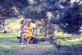 Happy and young pregnant couple on nature — Stock Photo