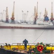 Sea port of Odessa. A crew member of one of the ships standing on the deck overlooking the port — Stock Photo #67275045