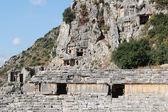 Ancient lycian Myra rock tomb ruins at Turkey Demre — Stock Photo