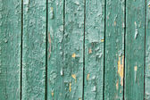 Old wooden painted green rustic background, paint peeling — Stock Photo