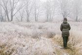 Woman walking in fog — Stock Photo