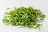 Fresh arugula leaves — Stock Photo
