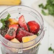 Homemade breakfast smoothie ingredients in a blender cup — Stock Photo #69652443