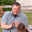 Father playing clapping game with his daughter — Stock Photo #77343754
