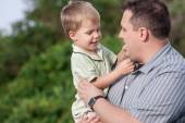 Father holding his 2 year old son — Stock Photo