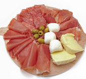 Mix italian style antipasto with prosciutto and mozzarella — Stock Photo