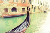 Vintage gondola moored on a canal — Stock Photo