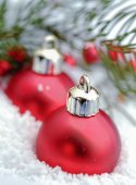 Christmas balls in the snow — Stock Photo