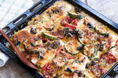Baked chicken breasts with zucchini, tomatoes, mushrooms and cheese — Stock Photo