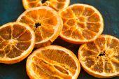 Dried orange slices on wooden background — Stock Photo